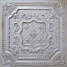 DCT 04 faux tin ceiling tile is a glue up tile that comes in Antique Copper, White Pearl, Antique White.