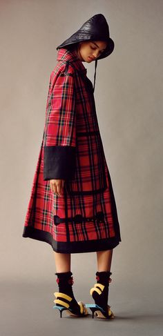 A Burberry September 2017 collection tartan car coat with turnback cuffs. Pictured in Vogue Magazine