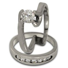 Half Ct Modern Engagement Duo Setting -  This bridal set has a total of 0.50ct of brilliant round accent diamonds and can support a center diamond of any size and shape.    An unusual contemporary wedding set in 14K white gold, this has 7 channel set diamonds. The band fits snugly into the engagement ring. The ring rises up from the shoulders to the center diamond which is elegantly set with four prongs.    The settings for our rings are made in our Florida factory using the finest gold…