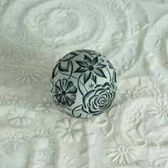 Textured Orb made for sand play. Stamp and roll in fine sand to make floral patterns. Many sphere designs to choose from!