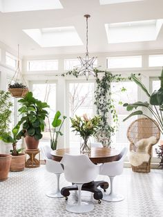The four-seasons conservatory was a recent addition to the home. Melissa is a dabbling horticulturalist and has cultivated an oasis in her New England carriage house.