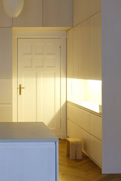 """An """"extra-warm artificial light"""" cloaks the side cabinet in what looks like sunlight."""