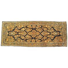 Antique Persian Sarouk Oriental Rug, in Small Runner Size, with Navy Blue Field | From a unique collection of antique and modern persian rugs at https://www.1stdibs.com/furniture/rugs-carpets/persian-rugs/