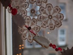 Starched doilies and garlands made of buttons and salt dough cut outs