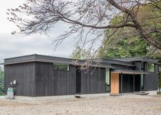 Blackened timber retreat by Studio Aula built in the woods near Tokyo