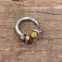Sterling Silver and Amber Ring Amber stones and sterling silver ring. Small Amber on sides of larger stone make the Amber visible from all angles. Only worn a few times. Size 8 Jewelry Rings