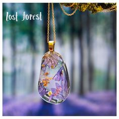 Brand new in store- The first of my eco resin pebble pendants is finally here This handcrafted, glossy pebble features lilac cornflower petals and gleaming gold leaf to create a beautiful and unique pendant for any nature lover only one made and available at lostforestshop.bigcartel.com