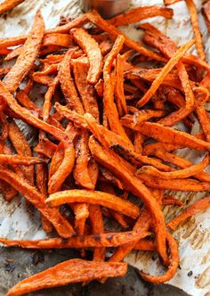 Crispy edges, soft center sweet potato fries baked not fried – so you can feel good about eating them! Once upon a time, we concocted the most amazing french fries made in the oven and we fell in love with them. We make them all the time and I can never seem to make enough …