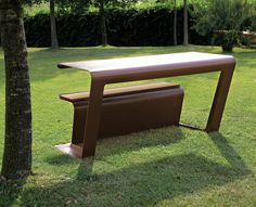 Bench-table made from shaping a single laser cut sheet, purposefully reinforced. The bench is modular and is ideal for picnic areas or public parks.
