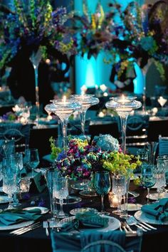 new years eve peacock themed wedding! teal and purple, hydrangeas, orchids and feathers! Styled by Anna Held Florist, Chicago.