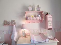 Scruffy bears - walls painted white with pink stripes.  Nursery is complimented with white furniture for a beautiful soft feel.