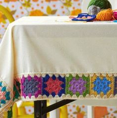 Crochet a granny square tablecloth. Only I would use crochet thread in muted colors. In fact, maybe I will. Crochet Borders, Crochet Squares, Crochet Granny, Crochet Motif, Crochet Designs, Crochet Doilies, Crochet Patterns, Granny Squares, Crochet Diy