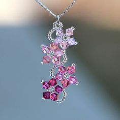 Featuring a stunning array of crystals, this necklace is accented with a unique floral design of pink crystal and beads. Handcrafted with sterling silver, this stylish necklace shines with a polished Bead Jewellery, Wire Jewelry, Jewelry Crafts, Jewelery, Handmade Jewelry, Jewelry Ideas, Handmade Wire, Handmade Necklaces, Jewelry Accessories