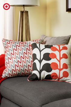 Give your living room a spring update with bright pillows in mixed prints and textures. The trick is to pick a common color, like red, and pair small pattern with large—it looks great but doesn't compete!