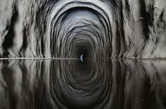 A worker stands inside the Cuncas II tunnel that will link canals being built to divert water from the Sao Francisco river for use in four drought-plagued states in Brazil, near the city of Mauriti, Ceara state, on January 28, 2014.