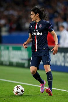 Edinson Cavani of PSG in action during the Group F UEFA Champions League match between Paris Saint-Germain v FC Barcelona held at Parc des Princes on September 30, 2014 in Paris, France.