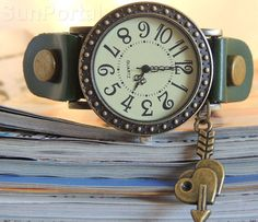 Unique watch with charm, vintage style, good quality, very fashionable great gift, adjustable band green leather