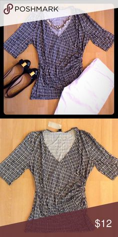ANN TAYLOR NWT faux wrap top  ANN TAYLOR top. Black and white. Size medium. V-neck, faux wrap, sleeves will hit at the elbow, fabric is cinched at the sides. 65% rayon 28% tencel lyocell 7% spandex. Never been worn, mint condition! Can be dressed up or down! Ann Taylor Tops Tees - Short Sleeve