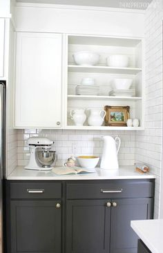 Another beautiful way of creating the feel of open shelving is by simply removing a cabinet door