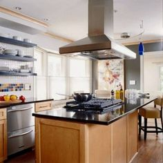 island cooktop | Island Hood over Wolf Range Top | Remodel ideas ...