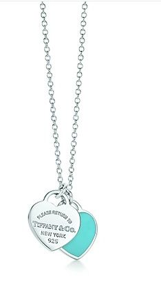 Design your own photo charms compatible with your pandora bracelets. Tiffany and Co. Double Heart Tag Pendant