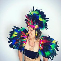 Multicoloured rooster and marabou feather festival wings, Burning Man inspired! These are absolute bad boys - Mad Max meets Moulin Rouge! Perfect for weddings, festivals, parties, burlesque or any soiree youve got in the pipeline. These wings are gorgeous and luscious. The feathers are multi layered. I have trimmed the wings sequinned elastic and multi coloured pom pom trim. The wings have been finished off with gorgeous gold beaded applique badges for extra vamp! The wings are attached…