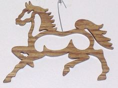 Scroll saw cut wooden horse ornament--3c. $6.50, via Etsy.