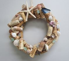This wine cork wreath is decorated with shells and sea glass found along the Texas Gulf Coast. Would look great on your front door or in your kitchen or bar area! It is 11 inches in diameter. Wine Craft, Wine Cork Crafts, Wine Bottle Crafts, Old Wine Bottles, Recycled Wine Bottles, Wine Corks, Clay Pot Crafts, Shell Crafts, Diy Crafts