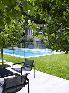 Backyard landscaping around swimming pool