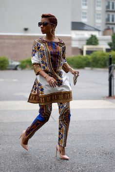 Some things don't require an explanation. ✊ xx HAVE FUN IN YOUR CLOSET! I'M WEARING: WHITE DASHIKI SET | Old nude heels | Express Clutch|Sunglasses