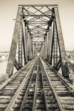 An old black metal train bridge over the North Saskatchewan River in Prince Albert, Saskatchewan. Processed with a monochrome infrared black and white filter. Great Photos, Cool Pictures, Saskatchewan Canada, Western Canada, Newfoundland And Labrador, Prince Albert, Train Rides, Train Travel, True North