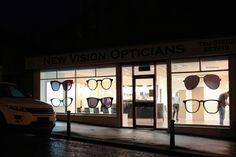 Optometry window display. Large glasses frames optical merchandising.
