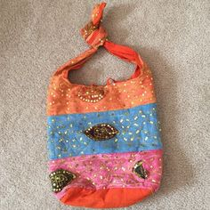 "⛱ SALE HPSlouchy boho sequin bag Beautiful shades of blue, pink and orange w/sequins. The knot at the top can be untied and worn cross-body. The few loose threads and fading at bottom are intentional to the design. Inside is some light dirt marks. Zipper interior pocket. Tie closure. No rips, tears or major wear. 11"" across, 13"" long, 4.5"" wide, 18"" shoulder drop. Bundle/make offer. Boutique Bags Crossbody Bags"