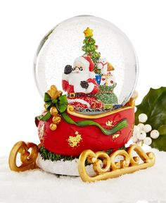"Santa's got his sled all packed and he's ready to go! The musical snow globe is decorated to look just like Santa's sleigh and plays ""Deck the Halls."" 