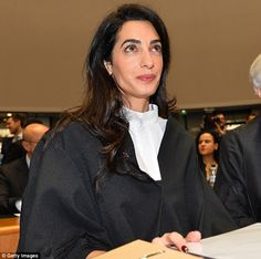 When asked about fashion, Mrs Clooney joked that she was wearing robe maker Ede & Ravenscroft.