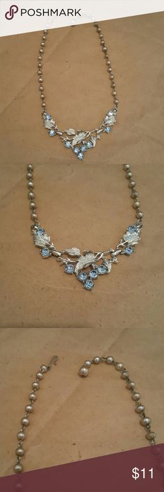 """Antiqued Pearls Silver Leaves  Blue Stone Necklace Costume jewelry necklace. Antiqued pearls. Silver leaves with shiny blue stones. Has hook closure. Measures 17""""long. Jewelry Necklaces"""