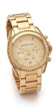 A gold-tone Michael Kors watch trimmed with sparkling crystals. Hinged-snap clasp.  Water resistant to 100 meters. 2-year manufacturer warranty. Imported.  MEASUREMENTS Dial: 1.5in / 4cm Band: 0.75in / 2cm Diameter: 3in / 7.5cm - Gold