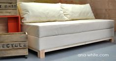 I want to make this! DIY Furniture Plan from Ana-White.com A sofa that you can build with a fold out seat perfect for storing extra pillows and blankets. Based off a sleeping pad foam cushion, so seating surface doubles as a guest bed.