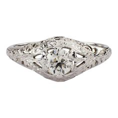 The open work setting, is set with an old European cut diamond, that weighs approximately