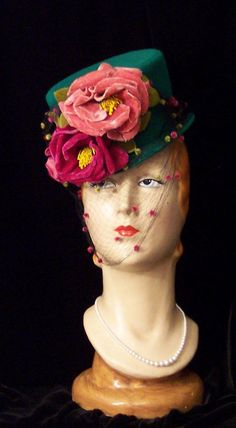 vintage green hat with roses and a veil.
