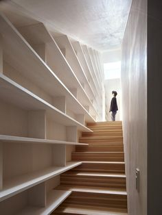 "Japanese architect Takao Shiotsuka's latest work is ""Cloudy House"" located in Oita, Japan. Shiotsuka has built a house which takes full advantage of the strength of the e Stair Shelves, Stair Storage, Bookshelves, Staircase Storage, Shelf Wall, Staircase Bookshelf, House Staircase, Interior Architecture, Interior And Exterior"