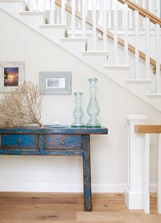 This particular blue in distress works with the light wood trim (trims are often white- furniture & walls look very different with wood trim). Perfect for the living room. Love the simple almost Shaker lines.