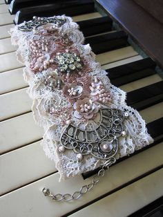 Angela Campos (Magical Mystery Tuca) is a talented artist . Magnificent beadwork on lace Bracelet. Lace Jewelry, Textile Jewelry, Fabric Jewelry, Jewelry Crafts, Vintage Jewelry, Handmade Jewelry, Jewellery Uk, Silver Jewellery, Antique Jewelry