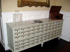 use old library card catalogs and reconstruct into an entryway table or sideboard/buffet ... for holding wine bottles