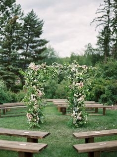 floral ceremony arch - photo by Rebecca Hollis http://ruffledblog.com/an-intimate-montana-wedding-awash-in-pink