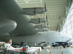 """Likely the most well known of all Hughes' aircraft, the Hughes H-4 Hercules, affectionately known as the Spruce Goose, was the largest aircraft in the world at the time of its construction.The aircraft was intended as a trans-Atlantic transport capable of defeating the German U-boat presence. Due to war time rationing, the contract specified the aircraft be made of """"non-critical materiel"""" leading to its famous moniker. It was powered by 8 R-4360 engines,"""