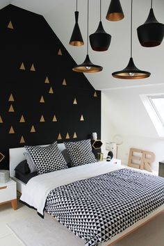 Bedroom. White, gold, and black interior. Love the wall and the pendant lamps!