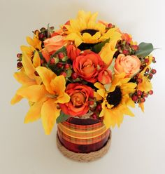 Autumn Zest Silk Floral Tabletop Centerpiece (with ribbons wrapped and cord technique). Ribbon Wrap, Business Profile, Novelty Items, Gift Baskets, Ribbons, Tabletop, Floral Arrangements, Party Favors, Cord