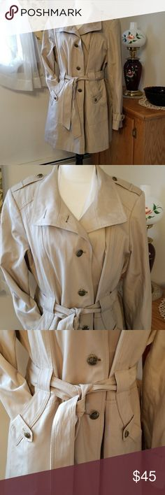 Gallery trench/rain coat XL EUC Tan in color  Contents: shell 57% cotton 43% poly                    Lining 100% polyester                     Made in Thailand  Care Instructuons: Machine wash cold,  gentle cycle with similar colors. Do not bleach. Tumble dry low. Cool iron if necessary  See pics for measurements (measurements are approximate)  Matte gold buttons, size XL, made by Gallery, EUC,  tie belt, 2 pockets Gallery Jackets & Coats