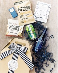 Gable boxes greeted guests upon their arrival to Virginia, and included a couple of nods to their current home in New York, like a mini chocolate bar from Mast, a bag of Pipcorn, and Saratoga water; it also had HannahMax cookie chips, a can of La Croix. #welcomebags #weddingideas #weddinginspo #weddingfavors | Martha Stewart Weddings - This Couple Personalized Every Element of Their Virginia Wedding